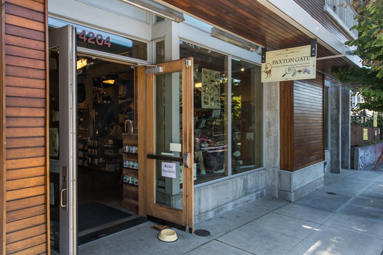 wooden exterior of storefronts with door open