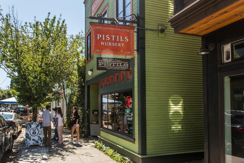 green shop exterior with pistil's shop sign