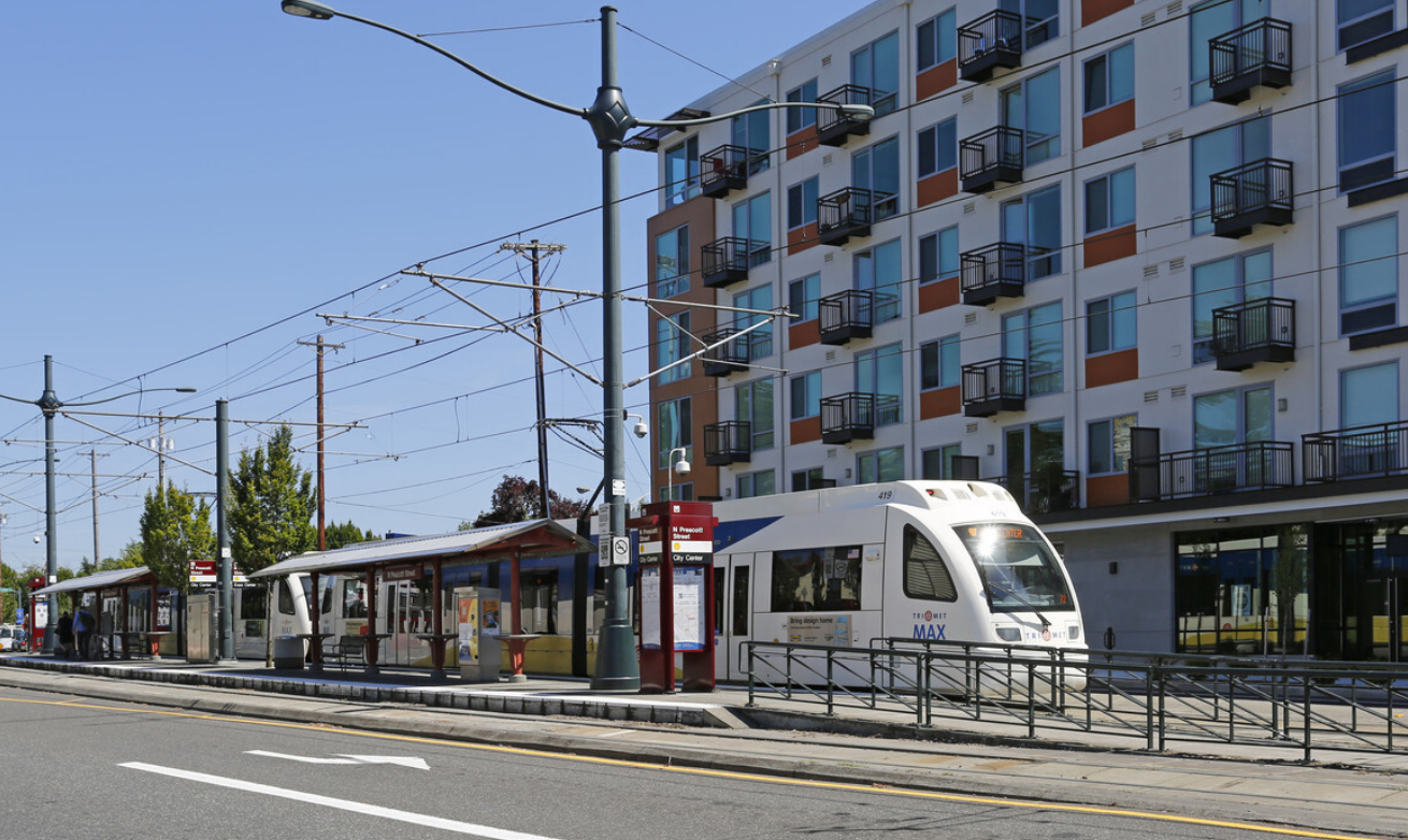 exterior of apparent building with streetcar passing by