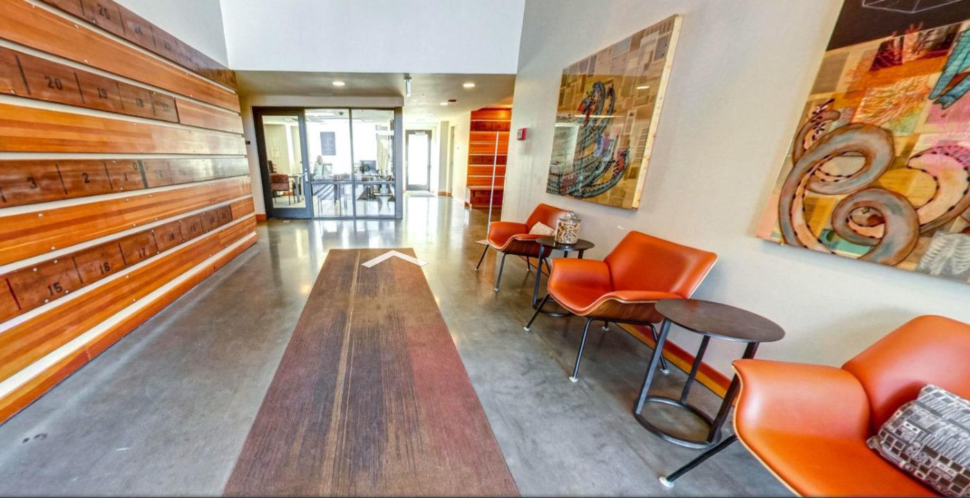 Prescott apartments lobby with orange chairs