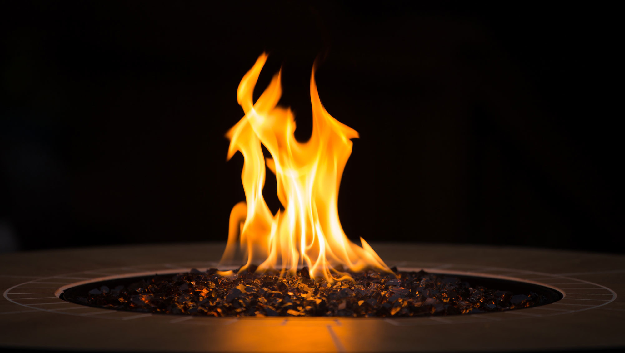 propane fire pit flame at night