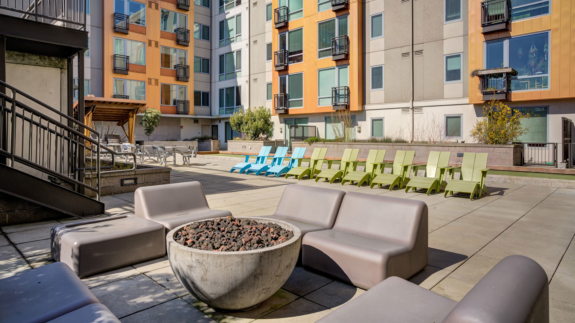 Outdoor fire pit surrounded by benches in Prescott apartment courtyard